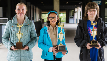 Students with trophies at Spelling Bee