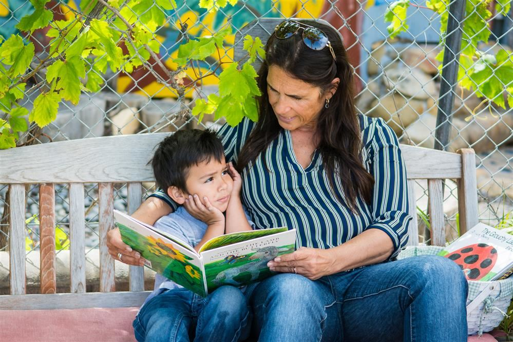 Teacher reading to boy